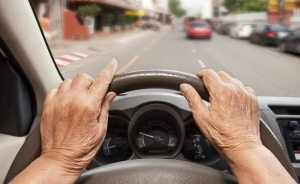 elderly-hands-driving