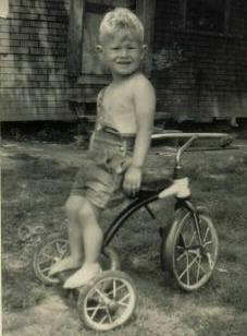 This image has an empty alt attribute; its file name is david-on-tricycle.jpg